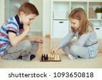 two little children playing... | Shutterstock . vector #1093650818