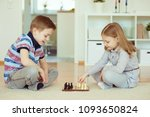two little children playing... | Shutterstock . vector #1093650824