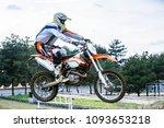 dirt bike rider is flying high | Shutterstock . vector #1093653218
