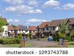 a quiet suburban cul de sac... | Shutterstock . vector #1093743788