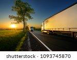 trucks driving on the asphalt... | Shutterstock . vector #1093745870