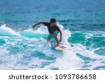 riding the waves. costa rica ... | Shutterstock . vector #1093786658
