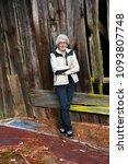 elderly woman  wearing a white...   Shutterstock . vector #1093807748