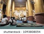 Burmese Man And Women Sit To...