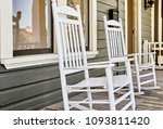 wooden rocking chairs on front... | Shutterstock . vector #1093811420