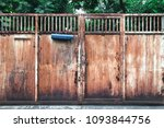 old rusty metal house gate with ... | Shutterstock . vector #1093844756