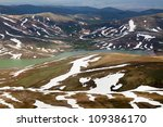 View fom head of mountain on valley - stock photo