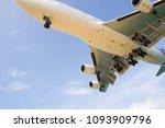 airplane landing to airport  | Shutterstock . vector #1093909796