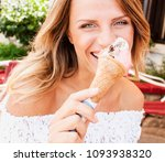 beautiful blond woman eat... | Shutterstock . vector #1093938320