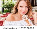 beautiful blond woman eat... | Shutterstock . vector #1093938323