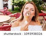 beautiful blond woman eat... | Shutterstock . vector #1093938326