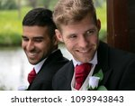 gay couple of grooms pose for... | Shutterstock . vector #1093943843