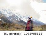 an asian traveller lady in warm ... | Shutterstock . vector #1093955813