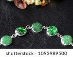 green resin bracelet on a dark... | Shutterstock . vector #1093989500