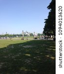 Small photo of Paris streets. Field between Seine (Alexander III bridge) and Palace of Invalids. View on Grand Palace. May 2018