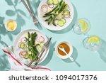 asparagus salad served on sunny ... | Shutterstock . vector #1094017376