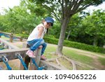 girl playing in the park | Shutterstock . vector #1094065226