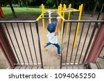 girl playing in the park | Shutterstock . vector #1094065250