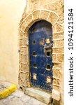 old metal dark blue door in old ... | Shutterstock . vector #1094121584