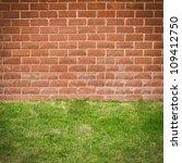 red brick wall with grass floor | Shutterstock . vector #109412750