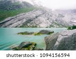 green river and mountains       ... | Shutterstock . vector #1094156594