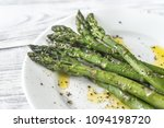 cooked asparagus on the plate | Shutterstock . vector #1094198720
