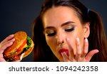 woman eating hamburger. girl...   Shutterstock . vector #1094242358