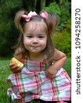 little girl devours her half of ...   Shutterstock . vector #1094258270