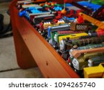 Small photo of Shiloh, IL—May 19, 2018; Toy trains sit on table waiting to be sold at garage sale. Thomas the Tank Engine collectible wooden toys are known for retaining a high resale value