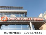Small photo of BELGRADE, SERBIA - APRIL 29, 2018: Logo of Opportunity Bank on their local headquarters for Serbia. Opportunity International is an NGo specialized in micro loans and microfinance