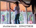 child decorates a window for... | Shutterstock . vector #1094275838
