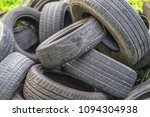 old discarded heap of rubber... | Shutterstock . vector #1094304938