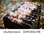 barbecue meat on the grill. | Shutterstock . vector #1094306198