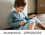 the modern child uses a tablet... | Shutterstock . vector #1094306204