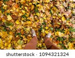 feet of a man standing on... | Shutterstock . vector #1094321324