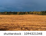 golden field in the background... | Shutterstock . vector #1094321348