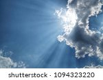 a beam of the sun behind the... | Shutterstock . vector #1094323220