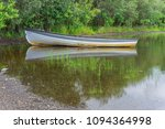 reflections of a rowing boat ... | Shutterstock . vector #1094364998