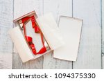 a pair of red sandals in a box | Shutterstock . vector #1094375330