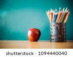 pencil box apple on the table ... | Shutterstock . vector #1094440040