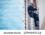 male worker rope access ... | Shutterstock . vector #1094445116