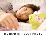 sick young woman in bed feeling ... | Shutterstock . vector #1094446856