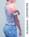 woman with shoulder pain. take... | Shutterstock . vector #1094450783