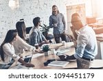 young coworkers. top view of... | Shutterstock . vector #1094451179