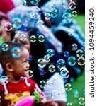 Small photo of BANDUNG, INDONESIA - APRIL 14, 2018: The little boy seemed happy to play balloon foam in the public park near Masjid Raya Bandung, Indonesia.