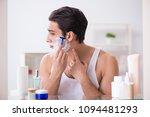 young handsome man shaving... | Shutterstock . vector #1094481293