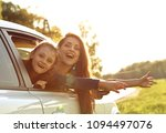 happy traveling laughing mother ... | Shutterstock . vector #1094497076