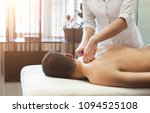 hands massaging male back and... | Shutterstock . vector #1094525108