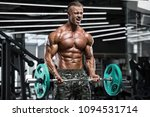 muscular man working out in gym ... | Shutterstock . vector #1094531714