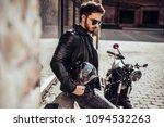 handsome bearded biker with... | Shutterstock . vector #1094532263